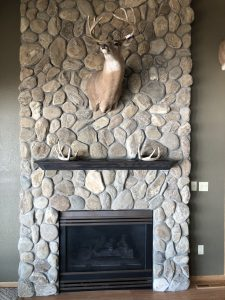 Floor to ceiling rock gas fireplace